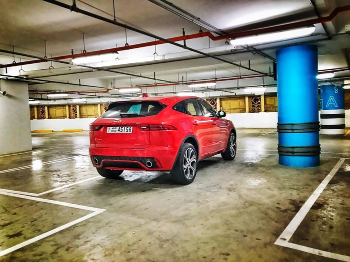 New Jaguar little cat seen in the wild! Dubai New Car Jaguar E Pace Jaguar Car ShotOnIphone Mode Of Transportation Transportation Land Vehicle Car Motor Vehicle Architecture Architectural Column City Built Structure No People Indoors  Red Parking Garage