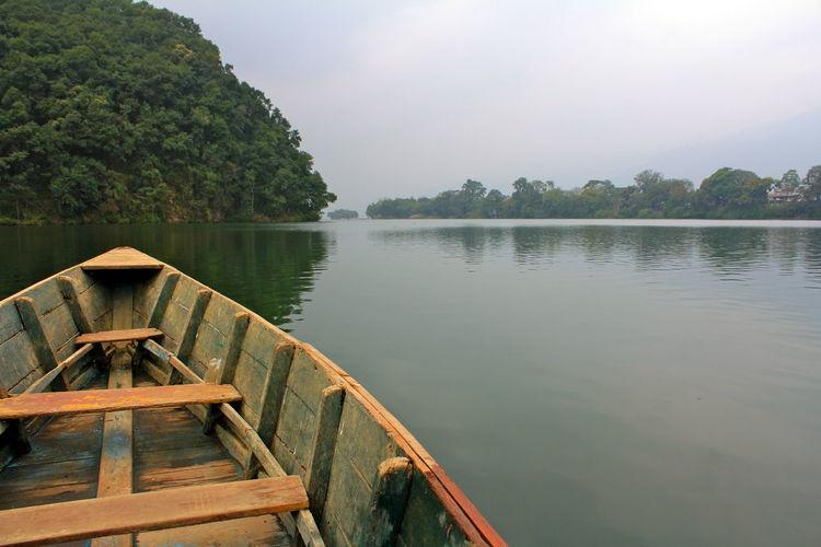 Cropped image of boat on lake