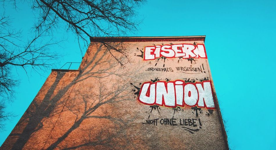 - EISERN UNION - Showcase March Sport German Soccer Slogan Graffiti Graffiti Art Streetphotography Union Berlin Köpenick My Fuckin Berlin Wall House Sky Blue Sky Blue Walking Around The City  Check This Out Eisern Union Football Fever