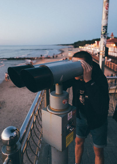 Photo of a friend Balticsea Kaliningrad Promenade Russia Canon Canon6d Canonphotography Clear Sky Coast Coin-operated Binoculars Day Friend Full Frame Hand-held Telescope One Person Outdoors People Real People Sea Sky Standing Sunset Telescope Water Zelenogradsk  First Eyeem Photo