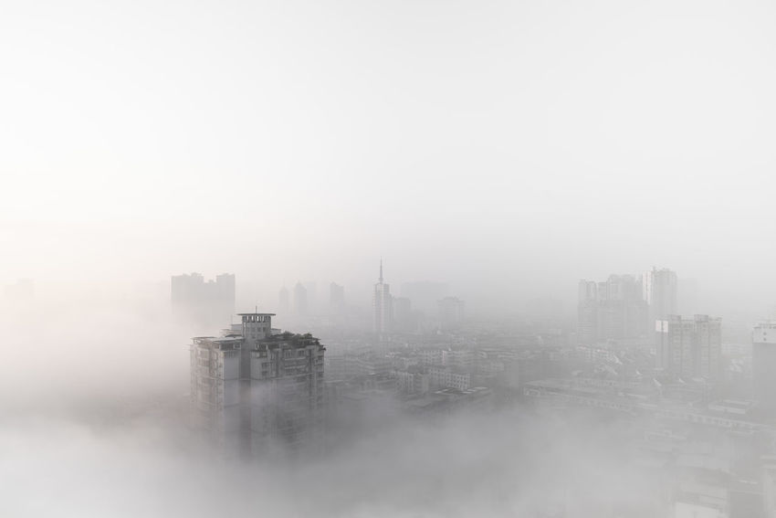 CIty immersed in fog or haze in China Fog Architecture City Building Exterior Cityscape Building Smog Sky Copy Space Pollution Haze Foggy Foggy Morning China City Weather