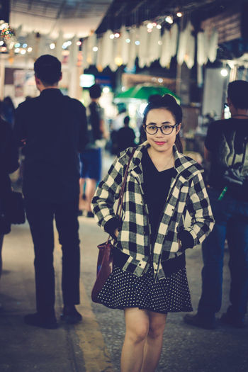 Portrait Of Young Woman In City At Night