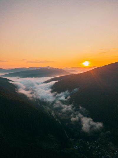 Beautiful sunrise in the carpathians with fog