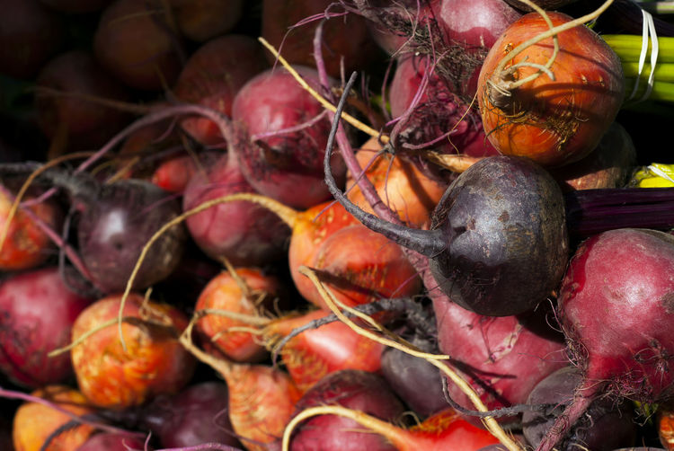 Colorful beets wait to be sold at a local farmer's market. Agriculture Cooking Farmers Market Natural Orange Abundance Backgrounds Beet Common Beet Food Food And Drink Freshness Harvest Harvesting Health Healthy Eating Market No People Organic Purple Raw Food Red Ripe Vegetable Veggie