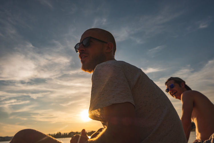 boys in the hood Sky Cloud - Sky Sunset Two People Portrait Portrait Photography Togetherness Friendship Annecy, France Lake Landscape Fujifilm Fujifilm_xseries FUJIFILM X-T2 Lifestyles Young Men Outdoors Colors EyeEmNewHere EyeEm Nature Lover EyeEm Best Shots Leisure Activity Real People Men Adult