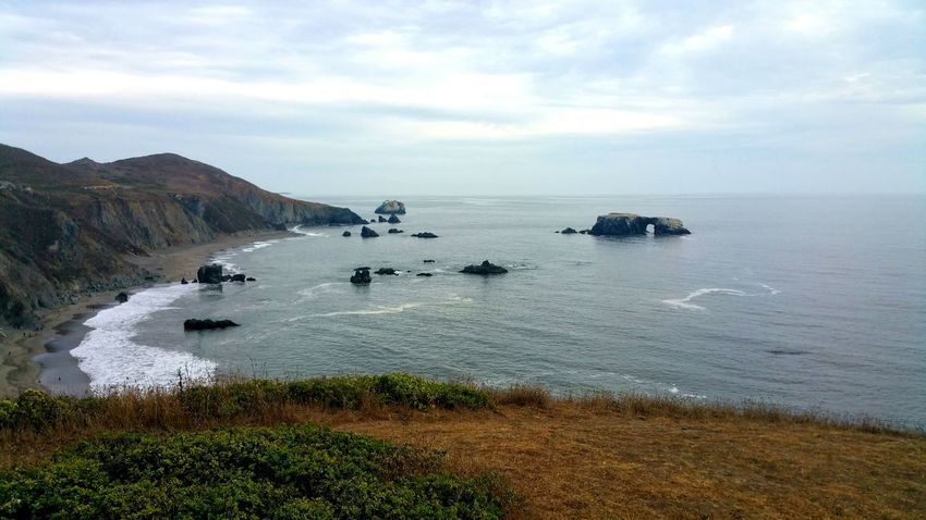 Atmospheric Dramatic Moody Fog Countryside People Tiny Distance Far Above Ocean Mysterious Romantic Dreamy Zen Golden Water Sea Beach Sky Horizon Over Water Rock Formation Coast Geology Natural Arch Cliff Tide Eroded Sandstone Rugged Shore