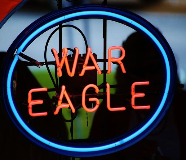 A neon sign shows the battle cry of the Auburn University Tigers. Auburn Tigers Auburn University Auburn, Alabama Blue Capital Letter Close-up College Life Communication Glowing Illuminated Information Lighting Equipment Neon No People Sign Text War Eagle Western Script