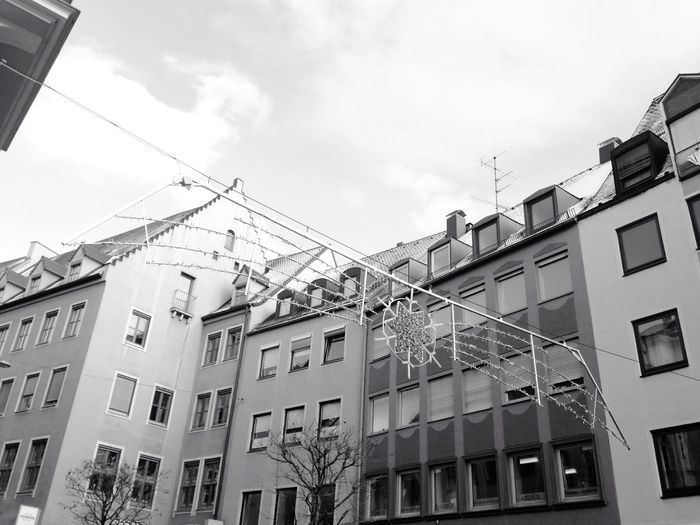 Building Exterior Architecture Low Angle View Built Structure Sky Window Balcony Residential Building No People Cable Day Outdoors City Fire Escape Air Conditioner Christmas Decoration Hello World Taking Photos Christmas Lights Christmastime