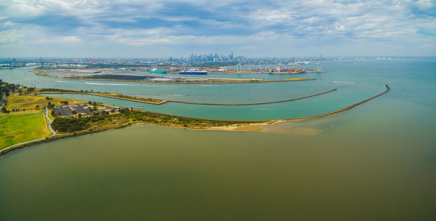 Aerial panoramic view of Yarra River Mouth with Melbourne CBD skyline on the horizon Australia Panorama Williamstown Aerial Landscape Aerial Panorama Aerial View Architecture Beauty In Nature Building Exterior City Day Harbor High Angle View Landscape Melbourne Mode Of Transport Moored Nature Nautical Vessel No People Outdoors Port Port Melbourne Reflection Sailing Scenics Sea Sky Summer Tranquil Scene Tranquility Transportation Water Waterfront Yarra River