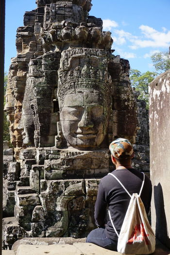 Angkor Thom Ancient Ancient Civilization Ancient Kingdom Architecture Art And Craft Belief Built Structure Day History History Building Human Representation Male Likeness One Person Outdoors Place Of Worship Religion Representation Sculpture Spirituality The Past Tourism Travel Travel Destinations