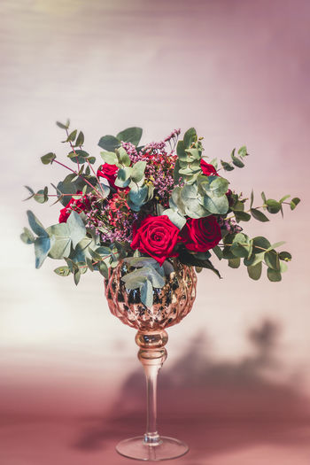 Close-up of red roses in vase on table