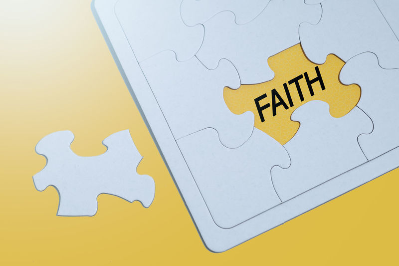 FAITH word on yellow surface and surrounds with white jigsaw puzzle. - Image Yellow Indoors  Jigsaw Piece Puzzle  High Angle View Solution Connection Communication No People Jigsaw Puzzle Strategy Close-up Business Studio Shot Pattern Technology Still Life Leisure Activity Relaxation Blank Faith Hope Have Faith