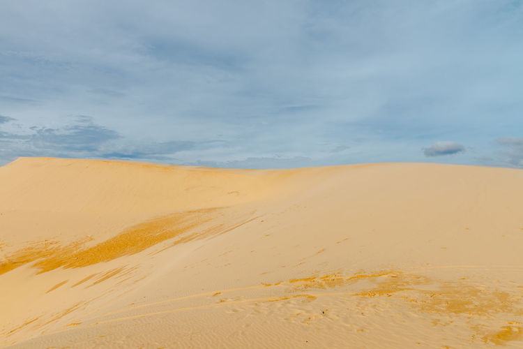 Sand dunes, Mui Ne South Vietnam Dec 2016 Sky, Vietnam, Arabia, Backgrounds, Blue, Travel, City, Cultures, Desert, Dessert, Dry, Heat – Temperature, Horizontal, Journey, Landscape, No People, Pattern, Binh Thuan Province, Indochina, Land, Mui Ne Bay, Natural, Outdoors, Panoramic, Photography, Red