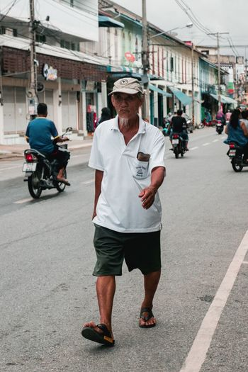 Step by step Elderly Old Old Man Street Tralvel Walking Steps City Architecture Street Building Exterior Built Structure Real People Men Adult Incidental People People Road Hat
