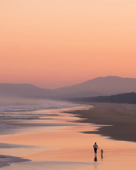 Beautiful Sunset , Lady Walking her dog on the beach Scenics - Nature Sunset Orange Color Sky Water Tranquil Scene Outdoors Leisure Activity Togetherness Dog Walking Dog Walking Dog Walking Dog Beach Walking Dog On Beach Woman And Dog