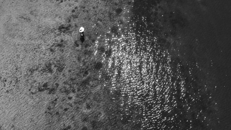 High angle view of man walking by sea