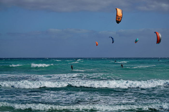 ks1 Adventure Aquatic Sport Beach Beauty In Nature Blue Corralejo, Fuerteventura Day Extreme Sports Horizon Over Water Kitesurfing Leisure Activity Lifestyles Motion Nature One Person Outdoors Parachute Scenics Sea Skill  Sport Surfing Vacations Water Wave