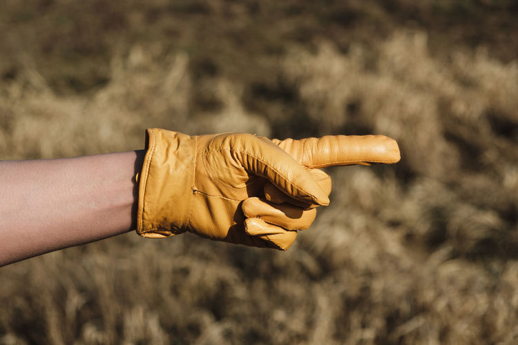 Yellow leather gloves hand pointing to the right Nature Sunny Winter Wintertime Adventure Close-up Day Direction Focus On Foreground Gesture Holding Human Body Part Human Hand Lifestyles Men Nature One Person Outdoors People Pointing Pointing Finger Real People Yellow Glove Series