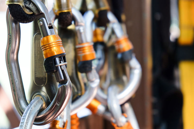 Climbing gear,Detail of Rock climbing equipment Climbing Gear Belayer Belaying Brewery Climbing Climbing Equipment Close-up Day Equipment Extreme Sports Hanging In A Row Indoors  Metal No People Rock Climbing ☺ Safety Selective Focus Sport Equipment