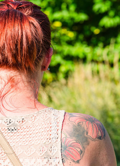 Rear View Of Woman With Tattoo On Shoulder