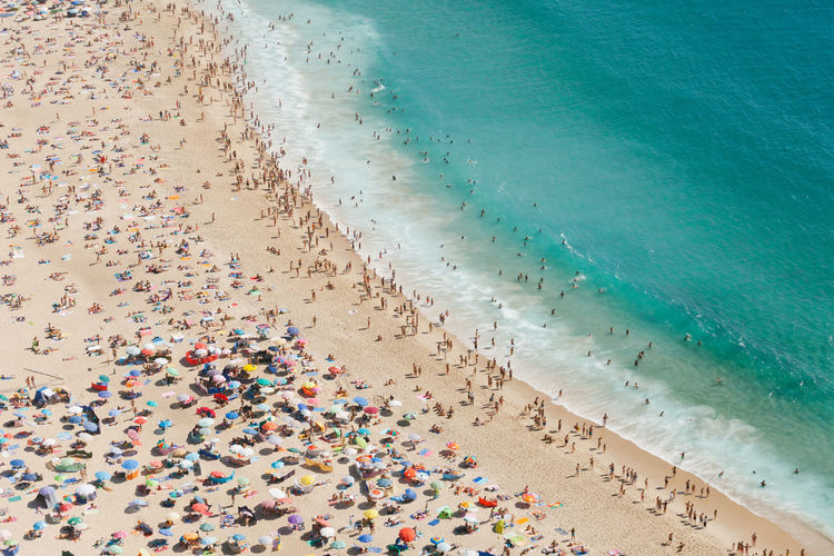 A Bird's Eye View Beach Beach Holiday Carefree City Life Coastline Colorful Crowd Day Enjoyment Fun High Angle View Large Group Of People Nature Ocean Relaxation Sand Sea Shore Summer Tourism Travel Destinations Vacations Vibrant Color Water