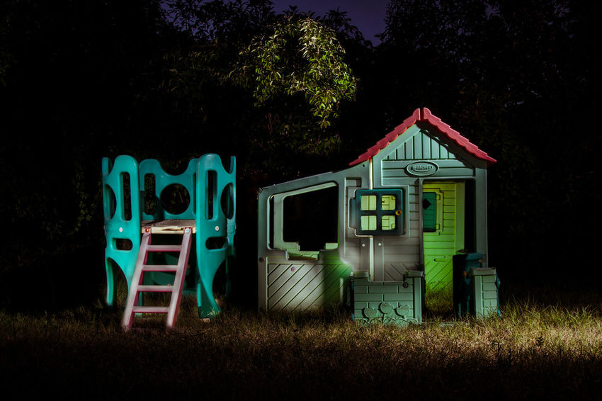 Night No People Western Script Illuminated Outdoors Architecture Dark Park Hut Plastic Plastic Castle Toy Plastic Hut Funny Stuffed Toy Written Deterioration Run-down Weathered Obsolete