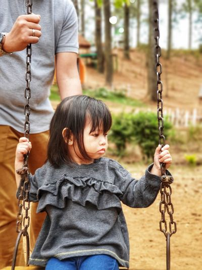 Full length of a girl on swing at playground