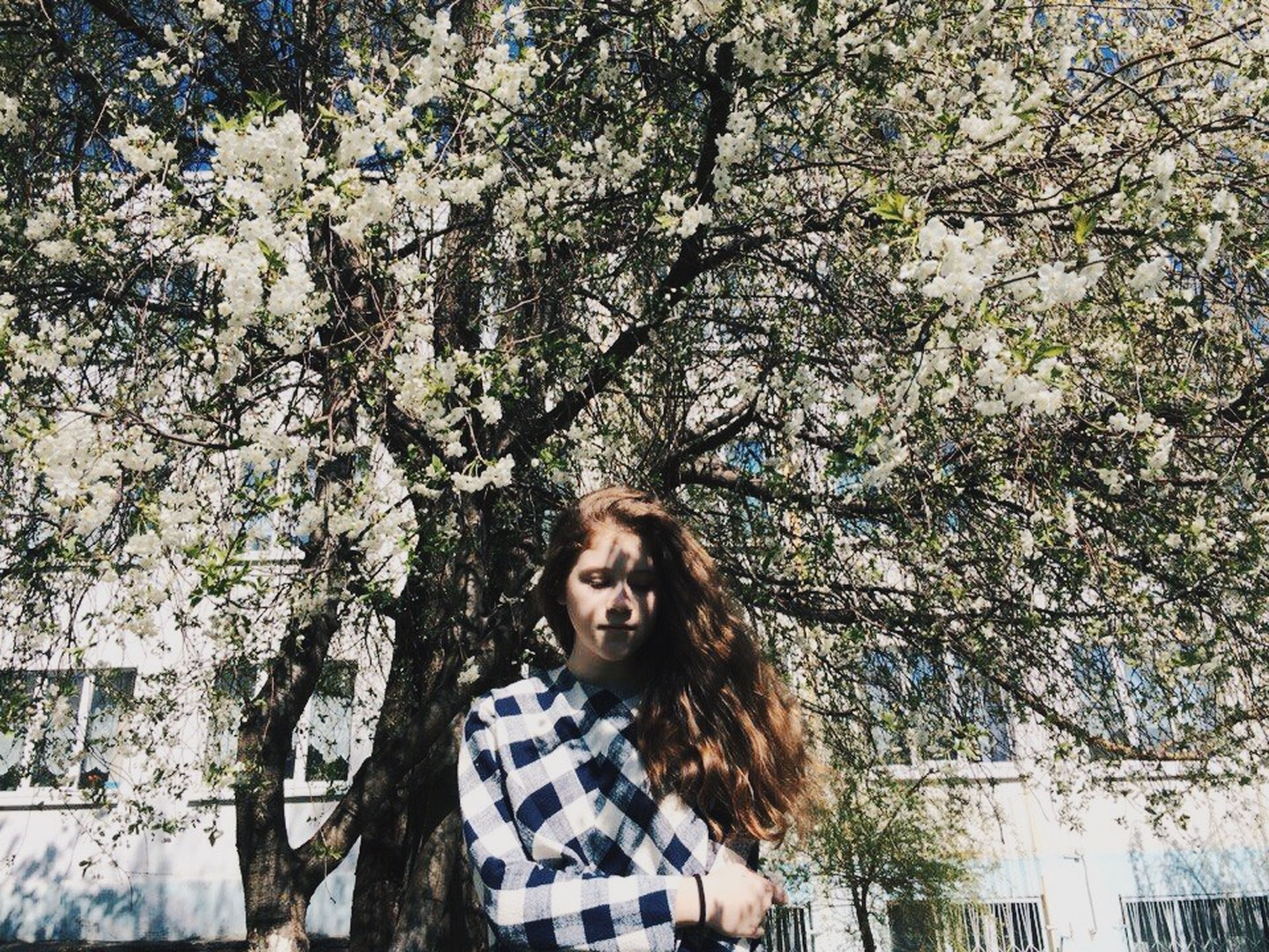 person, tree, young adult, lifestyles, looking at camera, portrait, casual clothing, leisure activity, smiling, young women, front view, standing, waist up, branch, happiness, day, nature, park - man made space