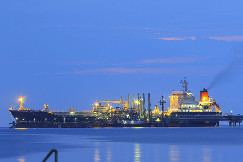Cargo ship at the blue sky Architecture Blue Built Structure Dusk Factory Fuel And Power Generation Illuminated Industry Nature Nautical Vessel Night No People Oil Industry Outdoors Reflection Sea Sky Transportation Water Waterfront