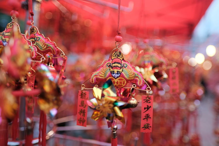 Close-up of decoration hanging for sale in market