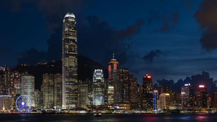 Hong Kong is an international metropolis and financial center IFC Sunset_collection Wheel Blue Lifestyles Long Exposure Metropolis Gallery Skyscraper Sunset