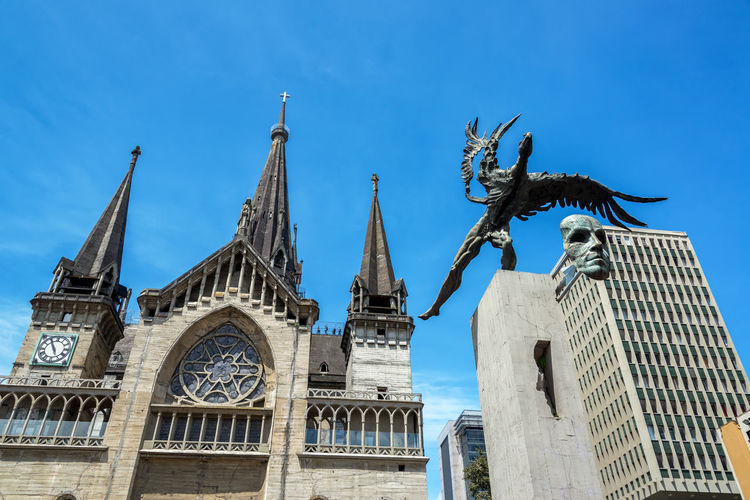 Low Angle View Of Monument And Manizales Cathedral Against Sky