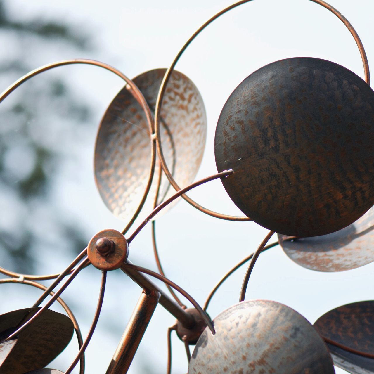 Low Angle View Of Metal Art Against Sky