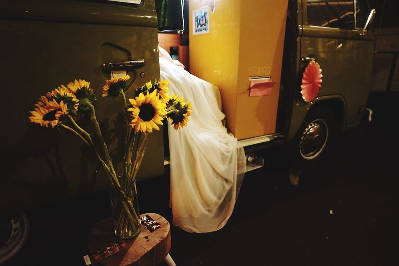 A bride in a vintage bus photo booth Mode Of Transportation Land Vehicle Flowering Plant Flower Plant Car Transportation Motor Vehicle Flower Head Beauty In Nature Flower Arrangement