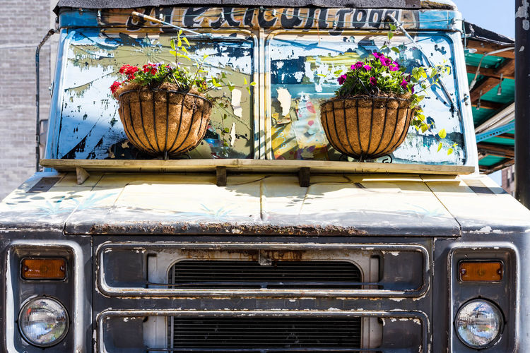 Mode Of Transportation Land Vehicle Transportation No People Car Motor Vehicle Day Retro Styled Travel Rusty Outdoors Vintage Car Flowering Plant Metal Flower Old Nature Stationary Text