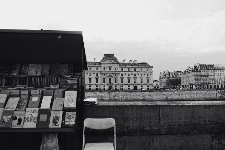 an Afternoon//. Paris Seine Riverside Books Outdoors City City Life Cityscape Streetphotography Waiting Built Structure Building Exterior Architecture Blackandwhite Black And White Lifestyles Life Building France Style Europe Travel View Urban Lifestyle Welcome To Black The Street Photographer - 2017 EyeEm Awards The Architect - 2017 EyeEm Awards
