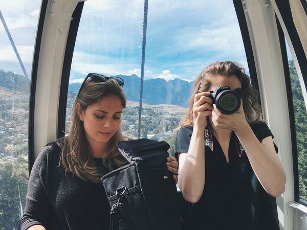 New Zealand Queenstown Two People Waist Up Young Adult Women Togetherness Front View Camera - Photographic Equipment Vacations Photographer Mountain