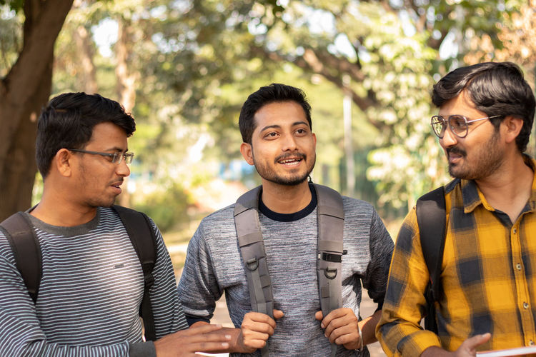 Group of young college students at campus, concept of youth friendship.