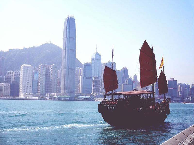 Junk Boat by the view of Hong Kong Cityscape