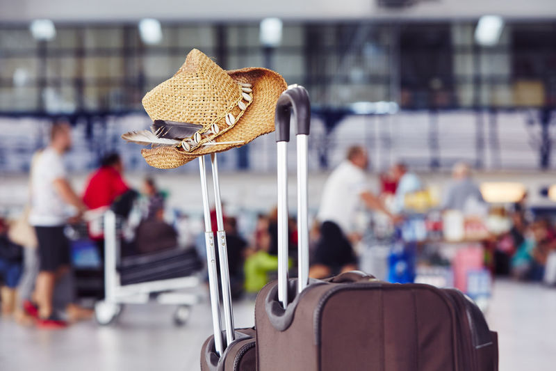 Hat on luggage at airport
