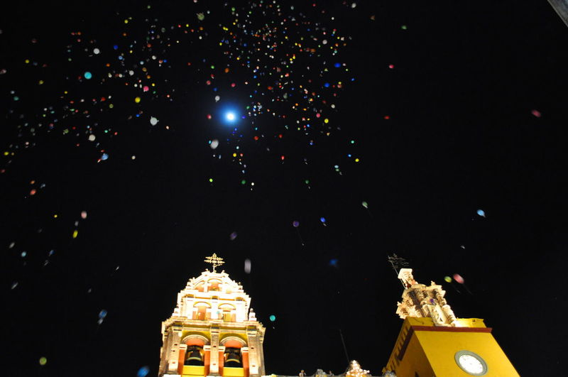 Three wise-men festival. Balloons holding wishes are released into the sky in the night by many children on the 6th of January in Guanajuato, Mexico. PPerspectiveAArchitecturebBalloonsBBlack BackgroundbBuilding ExteriorCCelebrationiIlluminatedLLow Angle ViewnNightnNight SkynNo PeopleoOutdoorssSky Breathing Space Paint The Town Yellow