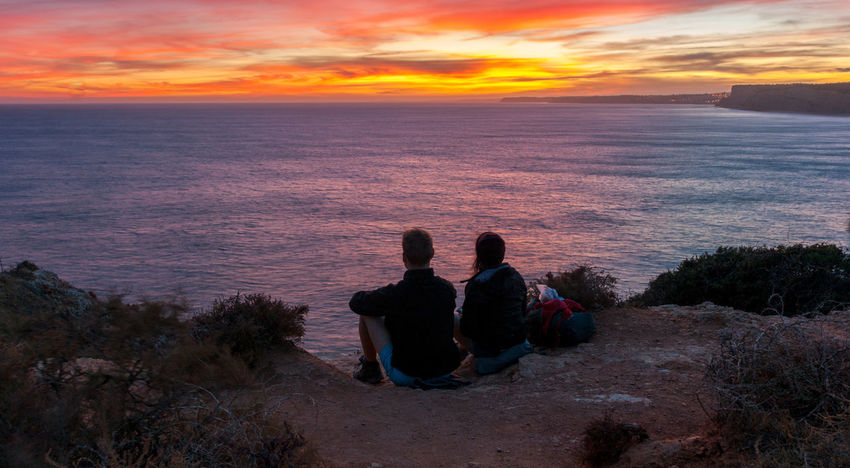 Cliffs Lost In The Landscape Portugal Beach Beauty In Nature Burningsky Cloud - Sky Lifestyles Love Nature Outdoors Sea Sitting Sunset Togetherness Travelingtogether Two People Water