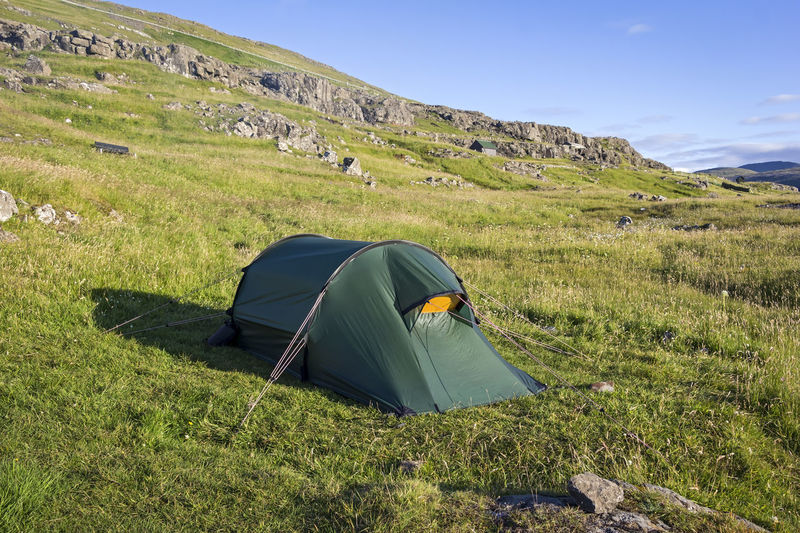 Scenic View Of Tent On Mountain Against Sky