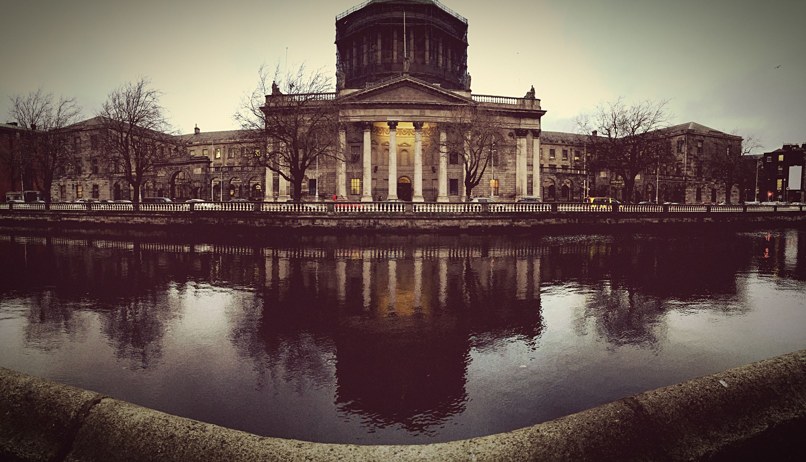 architecture, building exterior, built structure, reflection, water, waterfront, clear sky, sky, city, river, lake, history, pond, travel destinations, building, outdoors, famous place, day, place of worship, religion