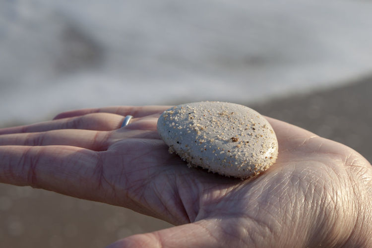 Beach Treasure Beach Body Part Close-up Day Finger Focus On Foreground Hand Holding Human Body Part Human Finger Human Hand Human Limb Lifestyles Nature One Person Outdoors Pebble Personal Perspective Real People Sand Smooth Stone Stone Stone In Hand Unrecognizable Person