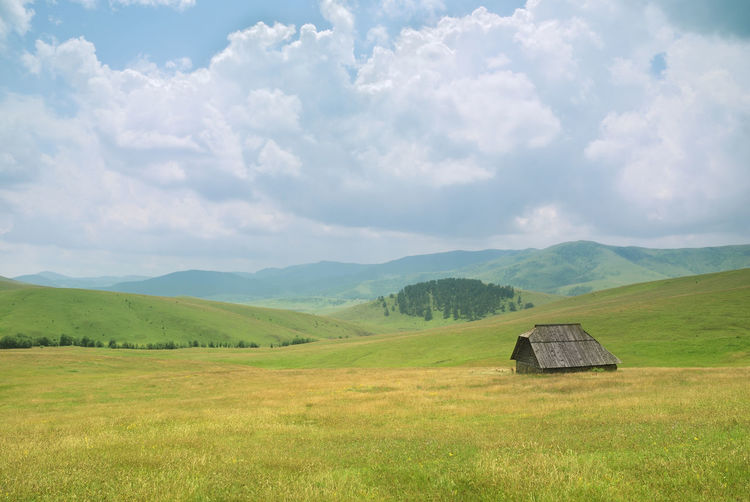Old Wooden House on Zlatibor Mountain in Serbia Plant Grass Nature Field Green Color Day No People Land Landscape Outdoors Environment Scenics - Nature Beauty In Nature Tranquil Scene Tranquility Mountain Non-urban Scene Rural Scene Idyllic Rolling Landscape Old House Zlatibor Serbia