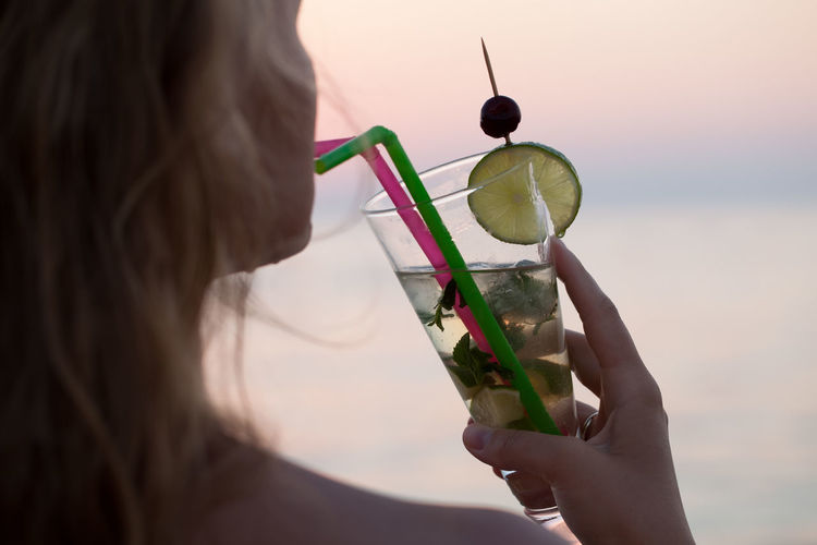 Beverage Citrus  Coast Drink Female Fruit Girl Green Color Horizontal Human Hand Mojito Refresh Refreshment Relax Relaxation Sea Seaside Summer Sunset