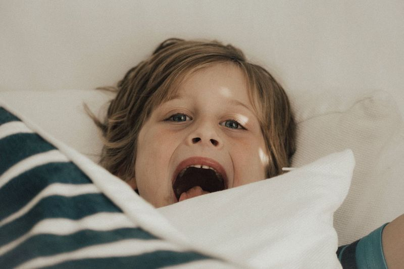 Indoors  Mouth Open One Person Headshot Looking At Camera Real People Portrait Childhood Bed Pillow Close-up Day People
