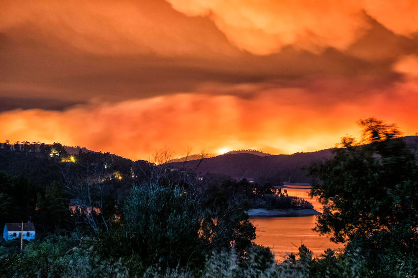 One of the Fires in Portugal 2017 Architecture Beauty In Nature Built Structure Cloud - Sky Day Fire Fires Landscape Mountain Nature No People Orange Color Outdoors River Scenics Sky Sunset Tranquil Scene Tranquility Tree Water