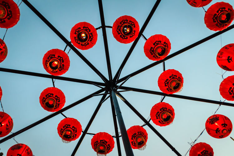 Beautiful Red Chinese Traditional Paper Lanterns that hanging and arranging in circle shape. For Chinese new year and celebration concept Celebration Chinese Lantern Circle Hanging Paper Lamps Arranged Arrangement Celebration Celebration Event Chinese Culture Chinese Lantern Chinese Lantern Festival Chinese New Year Circles Pattern Clear Sky Cultures Day Decoration Hanging Lantern Lighting Equipment Low Angle View No People Outdoors Paper Lamp Paper Lantern Paper Lanterns Red Traditional Festival